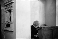 Mrs. Abraham Fogel, the only woman at Shabbat services in the Remu Synagogue. 1978