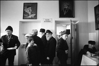 Warsaw's kosher kitchen at lunch after services in the Beit Midrash. Moshe Shapiro, center, waiting on line to receive his food. 1979