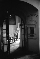 Adam Szmer cleaning up after kiddush in the Remu Synagogue. 1979