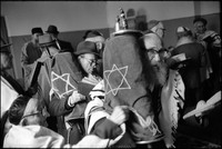 Shabbat service in Warsaw's Beit Midrash on Shavuoth.  Moshe Shapiro, front, and Natan Cywiak with Torahs. 1980
