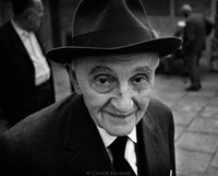 83-year-old Dr. Hieronim Krug, the oldest living advocate (lawyer) in Krakow, in the courtyard of the Remu Synagogue awaiting Friday night services. Like many Polish Jews, Krug survived the Holocaust by escaping east to Russia. 1975