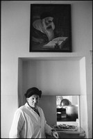 Solomon Klingkoffer at the window where meals are disbursed in Warsaw's kosher kitchen. 1979.