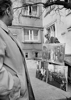 Jewish art dealer displaying 'supposed copies' of old paintings by Jewish artists,  In front of his Warsaw apartment building. 1979
