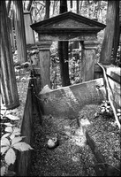 Vandalized tomb in Jewish Cemetery, Warsaw. It was believed by the local people that, when buried, Jews hide gold with the corpse.  1975