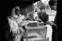 Robin Dawidowicz, the last Jew of Lublin's once Jewish market, and wife at work selling doughnuts. His wife, a Christian, had recently been beaten up and called a Jewish whore. They had been married for 4 months.  Dawidowicz endured Mauthausen concentration camp in Austria during the war. 1975