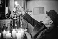Lighting candles before Friday night services at Remu Synagogue. Krakow 1978