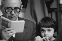 Moshe Abramson, with his daughter Mara, reading the Hagaddah at Passover Seder in Warsaw's kosher kitchen. 1979