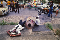 Exhausted drummer with Doc Paulin's brass band.  New Orleans 1978