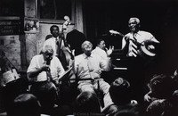 Willie Humphrey (center b. 1900) at Preservation Hall.  Narvin Kimball on banjo (b.1909).
