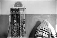 Saying the blessing for donning the tallit at morning services in the only Beit Midrash in Warsaw, adjacent to the unused Nozyk Synagogue. The Nozyk remained unused, too big and too cold for the few people who came to pray. 1979