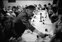 Passover Seder held in Warsaw's kosher kitchen. Mr. Czapnik pouring wine. 1979