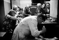 "Weekly Tuesday morning selling of ""kosher"" meat in the basement of Krakow's kehilla, the building where the official Jewish community has its office and kosher kitchen. ""It's as kosher as possible here"", said the butcher/ritual slaughterer (shochate) referencing current conditions in Poland. 1979"