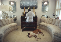 Count Basie playing organ in his living room with dog Graf (Count in German).