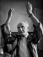 "Singing the Yiddish song, ""Who Will Say Kaddish* For Me?"" 76-year-old Max Ramenstein of Przemysl bemoans his fate.  When this picture was made, there were approximately 50 Jews left in Przemysl. In 1939 there were about 20,000. 1975  *(Kaddish is the prayer of remembrance for the dead.)"