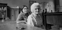 Golda Zeiden and daughter Regina in Wroclaw's only remaining prayer room (Beit Midrash).  Both survived Auschwitz.  1975