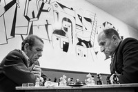 Chess players at the Jewish Club in Lodz. At the outbreak of WW II, one-third (230,000) of the city's residents were Jewish.  In 1975 approximately 500 remained, some gathering here to socialize. The mural, completed in 1960, by Adam (Aron) Muszka, is meant to depict the Holocaust. 1975
