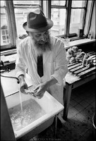 Moshe Shapiro, of Warsaw's kosher kitchen, washing meat. Shapiro, the kitchen's ritual slaughterer, was overseer to the cleanliness of both the food and kitchen according to Jewish law.  Money for the food and operation of the kitchen came from the American Jewish Joint Distribution Committee.  1975