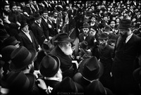 Menachem Mendel Schneerson, (1902-1994), known simply as the Rebbe, watched by his followers while making his entrance at Chabad-Lubavitch Headquarters in Brooklyn, NY.