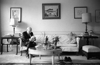 Isaac Bashevis Singer in his Manhattan apartment reading fan mail shortly  before flying to Stockholm to receive his Nobel prize for literature.