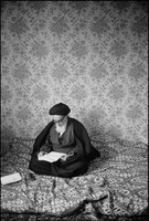 Ayatollah Ruhollah Khomeini in his room while in exile in Neuphe - le - Chateau, France, days before his triumphant return to Iran to lead its revolution.