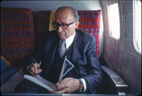 "Menachem Begin, Israeli prime minister and Polish Jew, inscribing my book ""Polish Jews: The Final Chapter"" on his plane during a US visit."