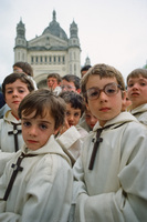 Altar boys in Lisieux, France following Pope John Paul II outdoor mass. 1980