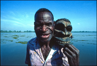 Marcus Mongwa, Sepik River artist, holding a sculpture he made containing human hair. Kaminabit Village, Middle Sepik, Papua New Guinea 1983