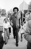Jesse Jackson escorting 2 girls to the first day of school as per a voluntary busing program in Chicago.