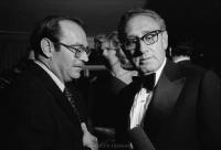 Secretary of State Henry Kissinger (r) and Israeli Ambassador to the United States Simcha Dinetz eyeing an intrusive microphone while in conversation.